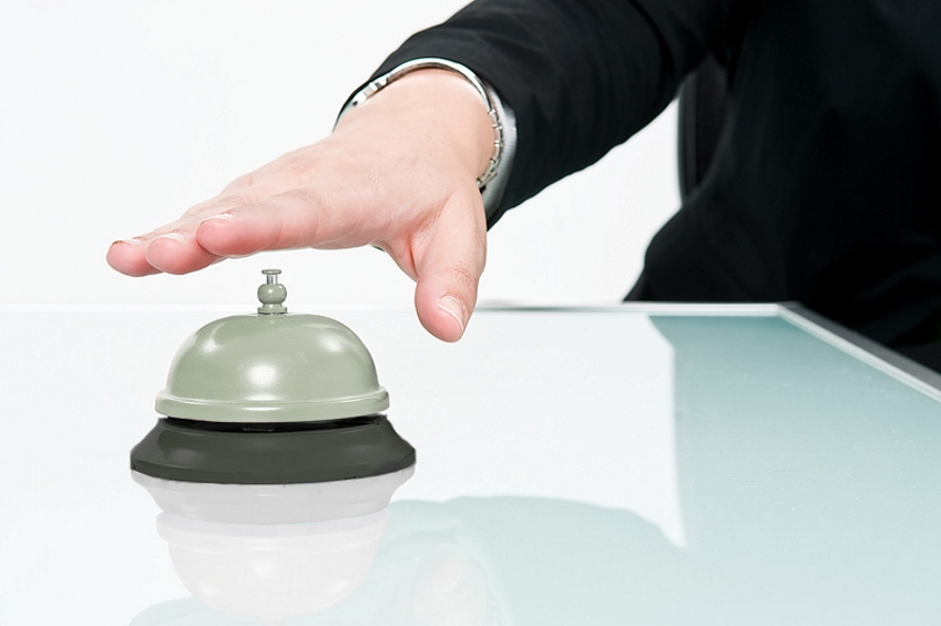 Person about to ring customer service bell